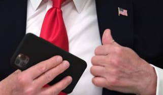 Donald Trump pockets his phone