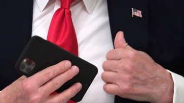 Donald Trump pockets his phone