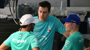 Mercedes boss Toto Wolff speaks with drivers Lewis Hamilton and Valtteri Bottas