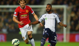Stephane Sessegnon of West Bromwich Albion vies with Daley Blind of Manchester United