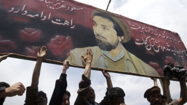 Afghans protest under an image of the late Ahmad Shah Massoud in Kabul in 2003