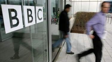 People leave the BBC building, in the corporation's West London headquarters, 21 March 2005. The BBC is to axe 2050 jobs in a second wave of cuts to save hundreds of millions of pounds, the c