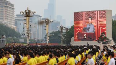 A screen shows Xi Jinping making a speech during celebrations marking 100 years of the CCP