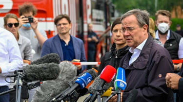 Armin Laschet speaks to reporters during a visit to Erftstadt, North Rhine-Westphalia