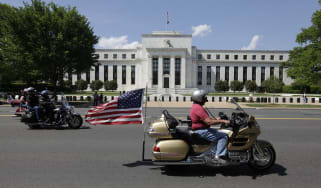 Motorcycclist participating in the The Rolling Thunder First Amendment Demonstration Run ride by the Federal Reserve Building in Washington, DC, on May 24, 2015. The Rolling Thunder First Ame