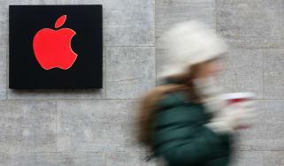 A pedestrian walks past an Apple store in Ireland