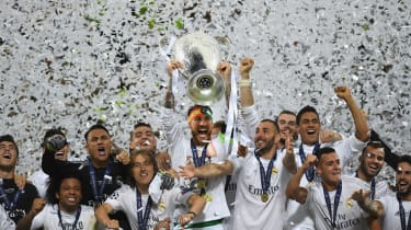 Real Madrid's Sergio Ramos lifts the Champions League trophy after his team's victory against Atletico Madrid in Milan