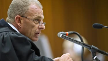 PRETORIA, SOUTH AFRICA - APRIL 11: (SOUTH AFRICA OUT): State prosecutor Gerrie Nel questions Oscar during cross examination in the Pretoria High Court on April 11, 2014, in Pretoria, South Af