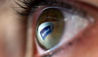 Reflection of the Facebook logo