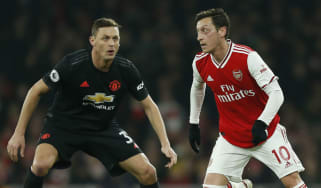 Arsenal's Mesut Ozil (right) in action against Manchester United in the Premier League