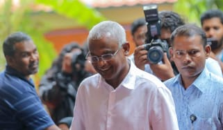 Opposition Maldives candidate Ibrahim Mohamed Solih arrives at a polling station to vote