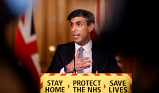 Rishi Sunak presents a post-budget press briefing.