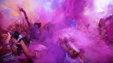 DUBAI, UNITED ARAB EMIRATES - NOVEMBER 29:12,000 Color Runners take part in the 'Happiest 5k on the Planet', turning Dubai Autodrome into a giant rainbow! The Color Run presented by Daman's A