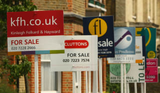 Property for sale signs in London, England