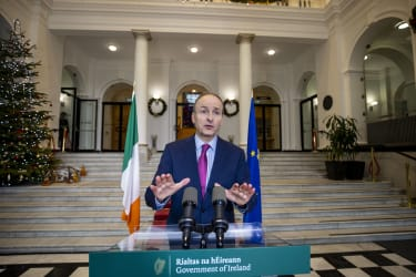 Irish Prime Minister Micheal Martin making a televised address.