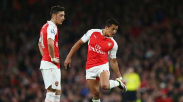 Mesut Ozil and Alexis Sanchez of Arsenal
