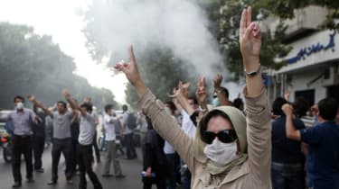 A woman protests during last major demonstrations in Tehran in 2009