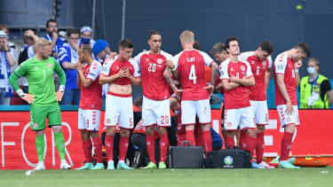 Denmark's players formed a protective shield around Christian Eriksen