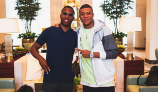 Former Liverpool striker Daniel Sturridge poses for a picture with French star Kylian Mbappe