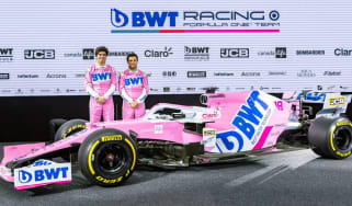 Racing Point drivers Lance Stroll and Sergio Perez stand next to the RP20 F1 2020 car