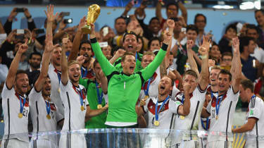 The German squad hoists the World Cup