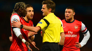 LONDON, ENGLAND - FEBRUARY 19:Bacary Sagna of Arsenal appeals to Referee Nicola Rizzoli during the UEFA Champions League Round of 16 first leg match between Arsenal and FC Bayern Muenchen at