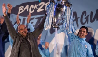 Manchester City manager Pep Guardiola and assistant coach Mikel Arteta celebrate the 2018-19 Premier League title win