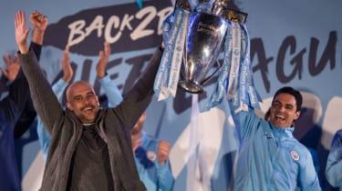 Manchester City manager Pep Guardiola and assistant coach Mikel Arteta celebrate the 2018-19 Premier League title win