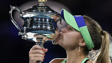 Sofia Kenin kisses the Daphne Akhurst Memorial Cup after winning the Australian Open