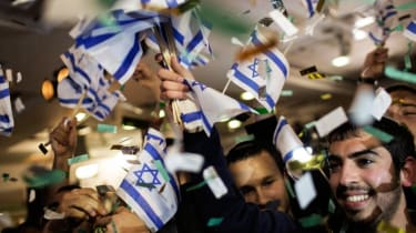 Supporters of the Israeli hard-line national religious party, Jewish Home, celebrate after general election exit polls were a