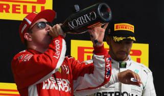 Kimi Raikkonen celebrates his win at the F1 United States GP while Mercedes driver Lewis Hamilton finished third