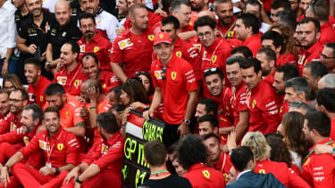 Charles Leclerc and the Ferrari team celebrate the driver's victory at the F1 Italian Grand Prix