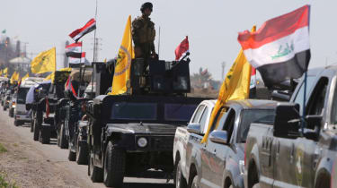 Iraqi security forces head towards the al-Dawr area, south of Tikrit