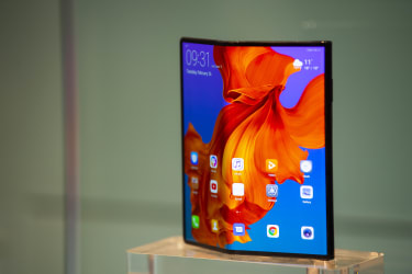 BARCELONA, SPAIN - FEBRUARY 26:The new Huawei Mate X mobile phone is shown on display at the Huawei booth on day 2 of the GSMA Mobile World Congress 2019 on February 26, 2019 in Barcelona, Sp