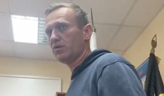 Alexei Navalny in a Moscow police station following his arrest