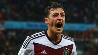 Mesut Ozil celebrates scoring the winner for Germany