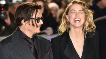 US actor Johnny Depp (L) jokes with fiancee US actress and model Amber Heard (R) as they arrive for the UK premiere of the film 'Mortdecai' in London on January 19, 2015.AFP PHOTO / LEON NEAL