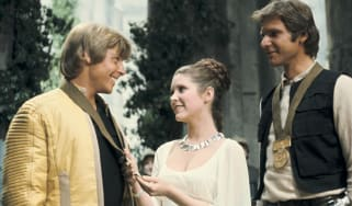 Carrie Fisher, as Princess Leia, wearing the Planetoid Valleys necklace and the Darina's Bracelet.