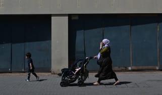 A Muslim woman walks down a street in London