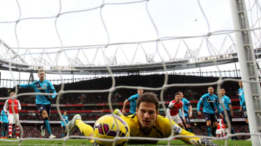 LONDON, ENGLAND - JANUARY 11:Asmir Begovic of Stoke City fails to stop the ball crossing the line as Alexis Sanchez (not pictured) of Arsenal scores his team's third goal from a freekick duri