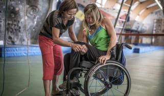 A paraplegic woman get assistance