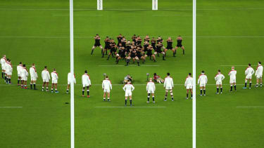 England players lined up in a V formation for New Zealand's haka before the Rugby World Cup semi-final