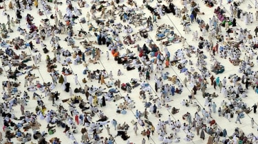 Muslim pilgrims wait for the start of prayers at the Grand Mosque in Mecca during the hajj