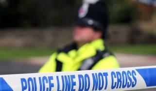 Police cordon off a crime scene