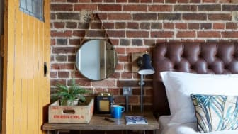 Red brick bedroom with desk
