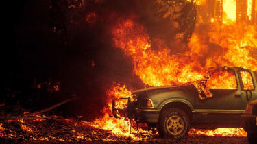 Vehicles and a home are engulfed in flames