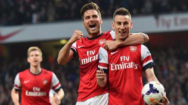 Olivier Giroud and Laurent Koscielny of Arsenal