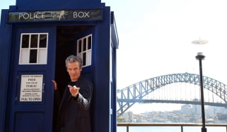 Doctor Who star Peter Capaldi poses in front of Sydney Harbour Bridge