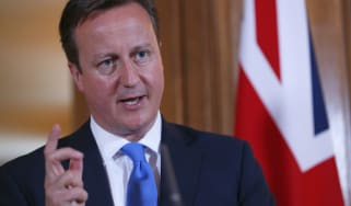 LONDON, UNITED KINGDOM - JULY 17:Britain's Prime Minister David Cameron answers a question during a joint news conference with Italy's Prime Minister Enrico Letta in 10 Downing Street on July