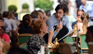 Waitress takes an order in central London restaurant